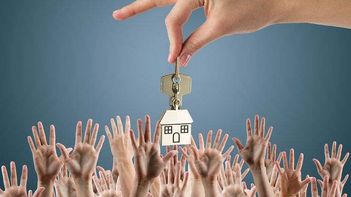 Keys to house with many hands