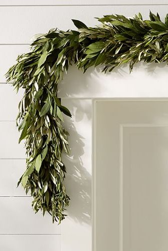 olive leaf garland over doorway