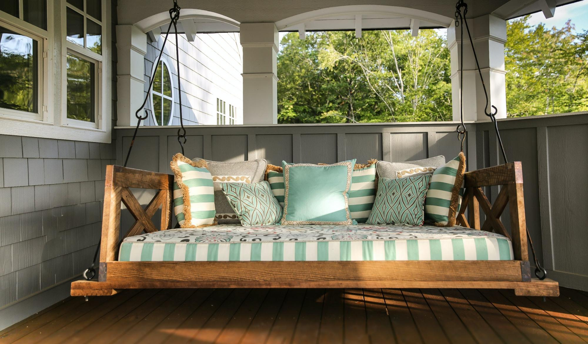 Front porch swing with pillows.