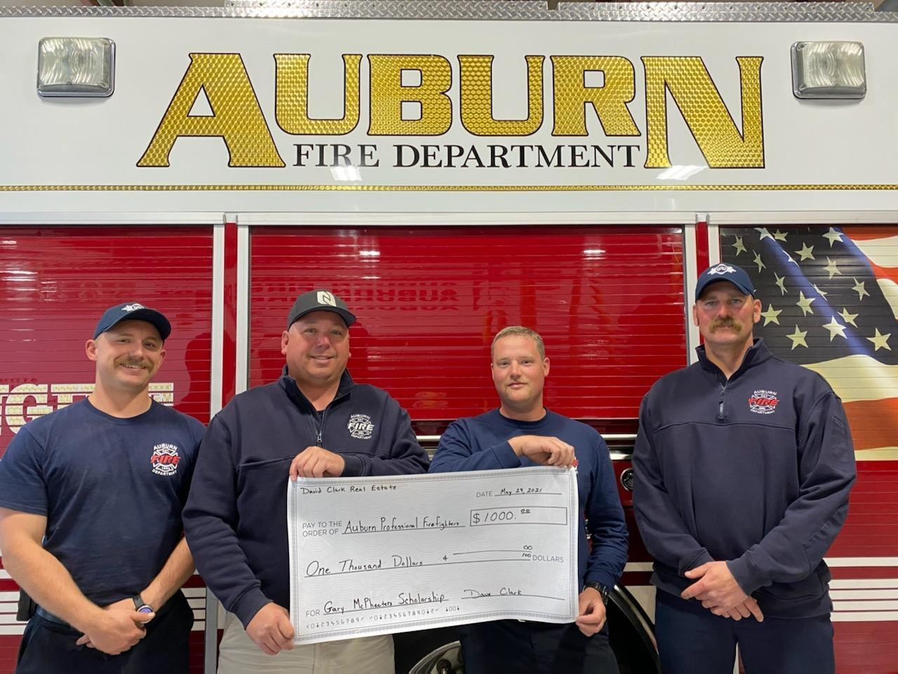 firefighters presenting check.