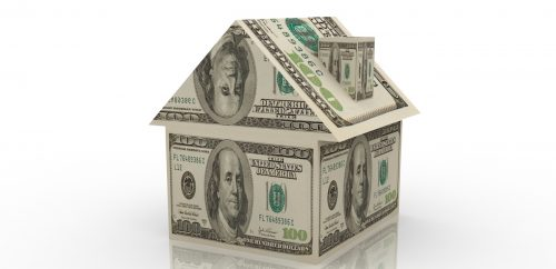 House constructed with dollar bills.